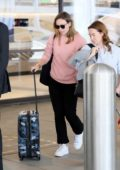 Olivia Wilde seen wearing a pink sweatshirt as she arrives at LAX airport in Los Angeles