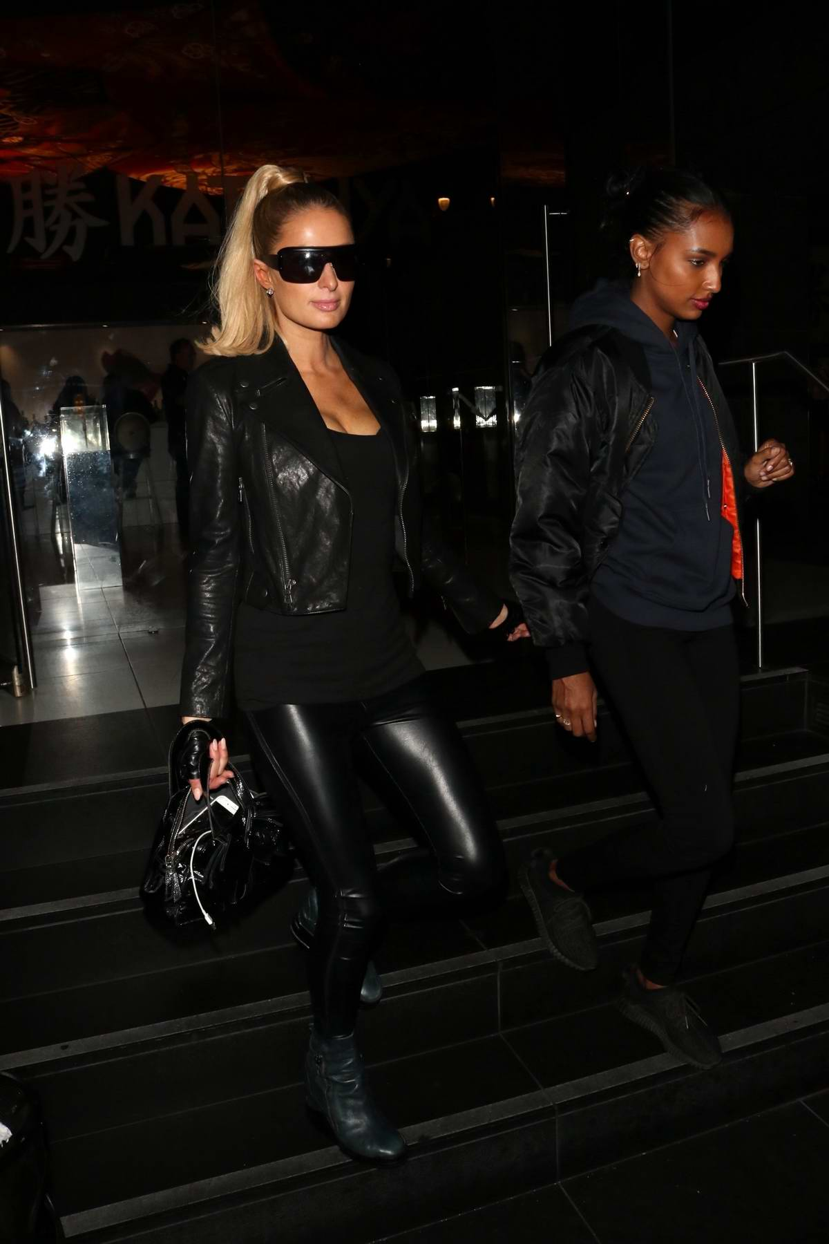 Paris Hilton and Jasmine Tookes step out for a night of fun at Katsuya in Hollywood, California