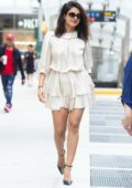 Priyanka Chopra flaunts her legs as she steps out in a short white dress in New York City