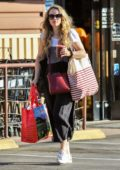 Rachel McAdams enjoys a fresh juice while shopping for groceries at Lassens Natural Food and Vitamins in Los Angeles