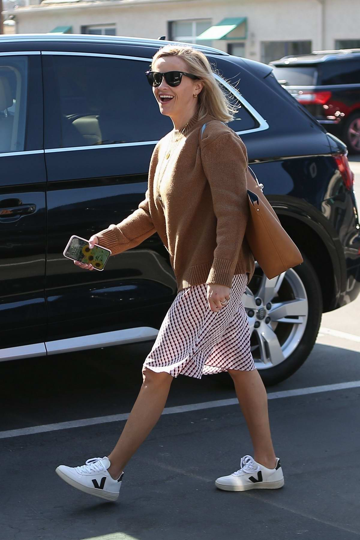 Reese Witherspoon is all smiles as she heads into her office at Hello Sunshine in Santa Monica, California