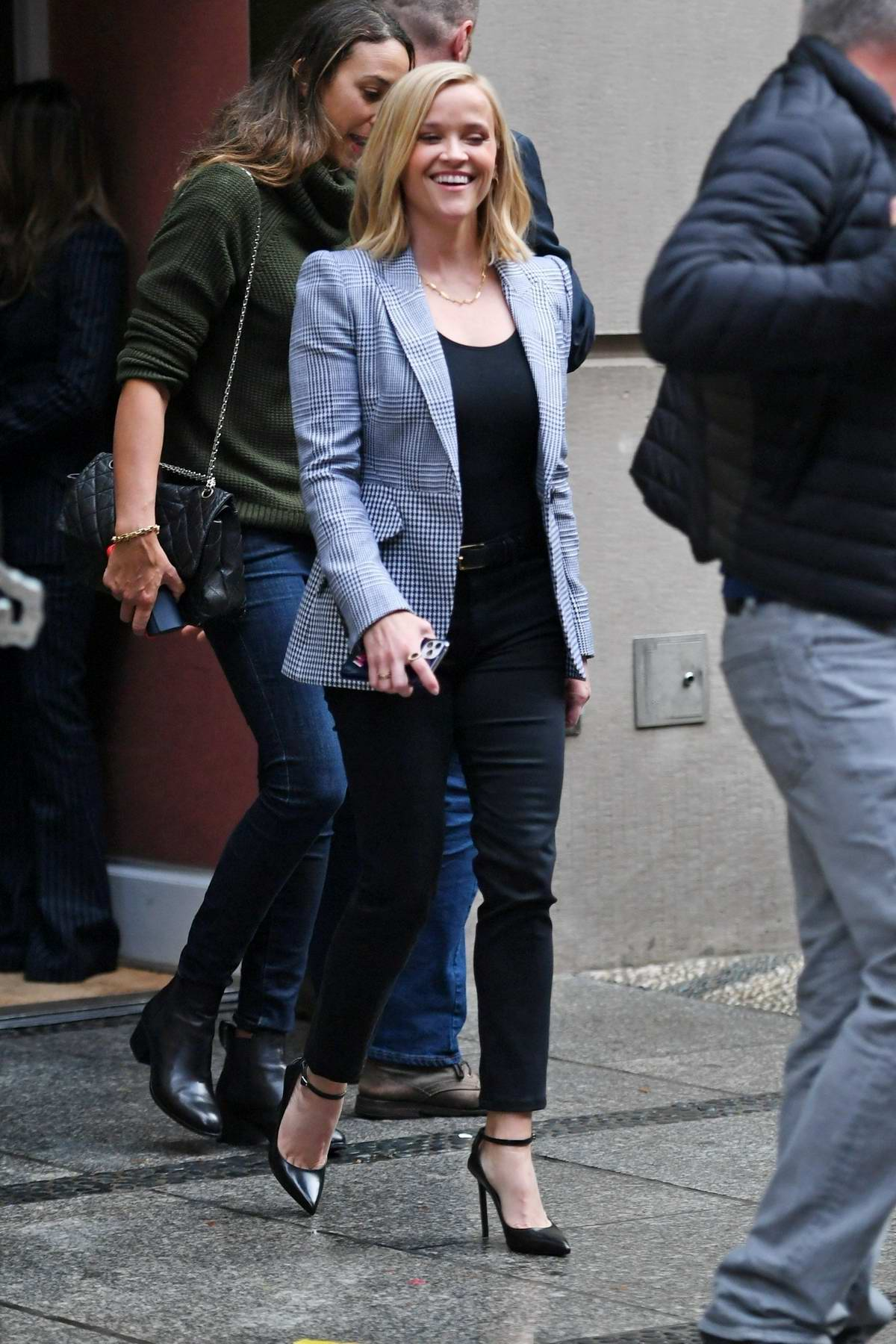 Reese Witherspoon is all smiles during 'The Morning Show' promo rounds in Soho, New York City