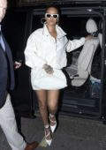 Rihanna dazzles in an all-white ensemble during a night out in Soho, London, UK