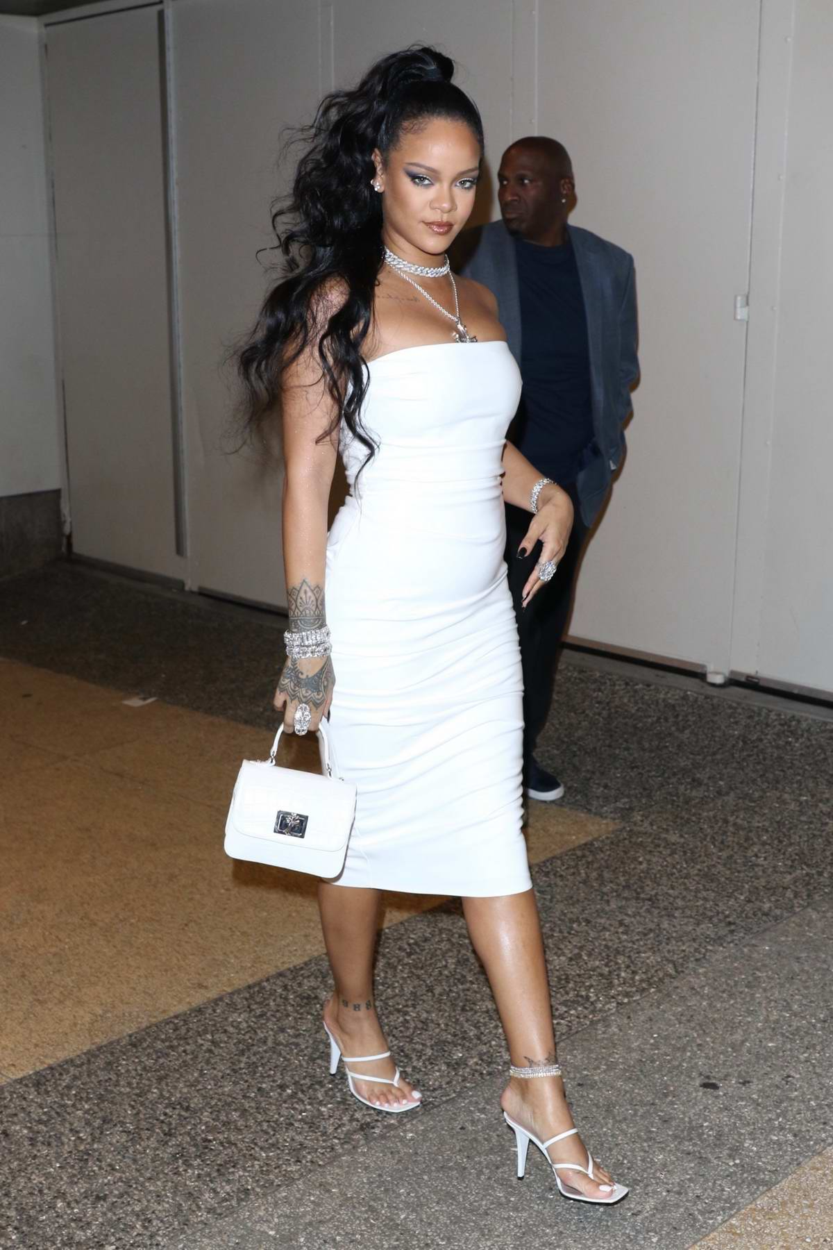 Rihanna looks stunning in all white as she arrives at her hairstylist Yusef Williams' Porcelain Ball in New York City