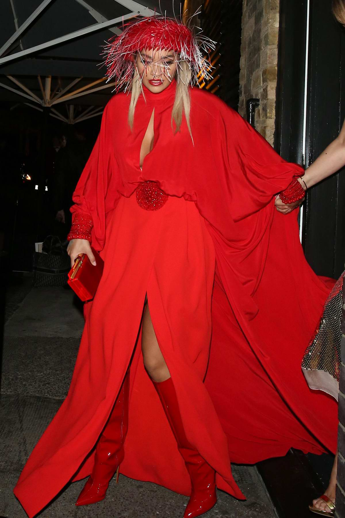 Rita Ora stands out in a bright red ensemble as she leaves Chiltern Firehouse in London, UK