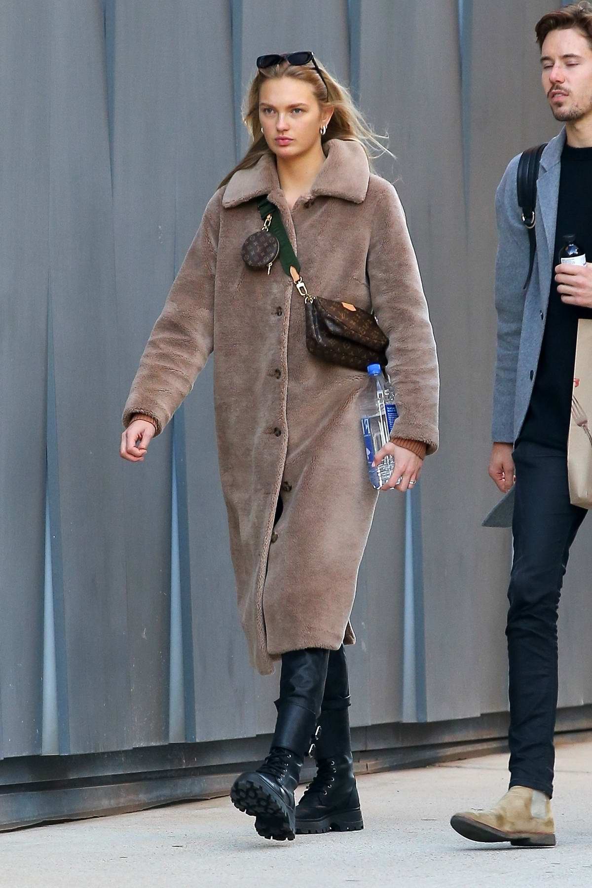 Romee Strijd bundles up in a cozy brown coat while out for a stroll with Laurens van Leeuwen in New York City