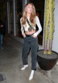 Romee Strijd flaunts her abs in a white cropped top as she leaves Catch restaurant in West Hollywood, Los Angeles