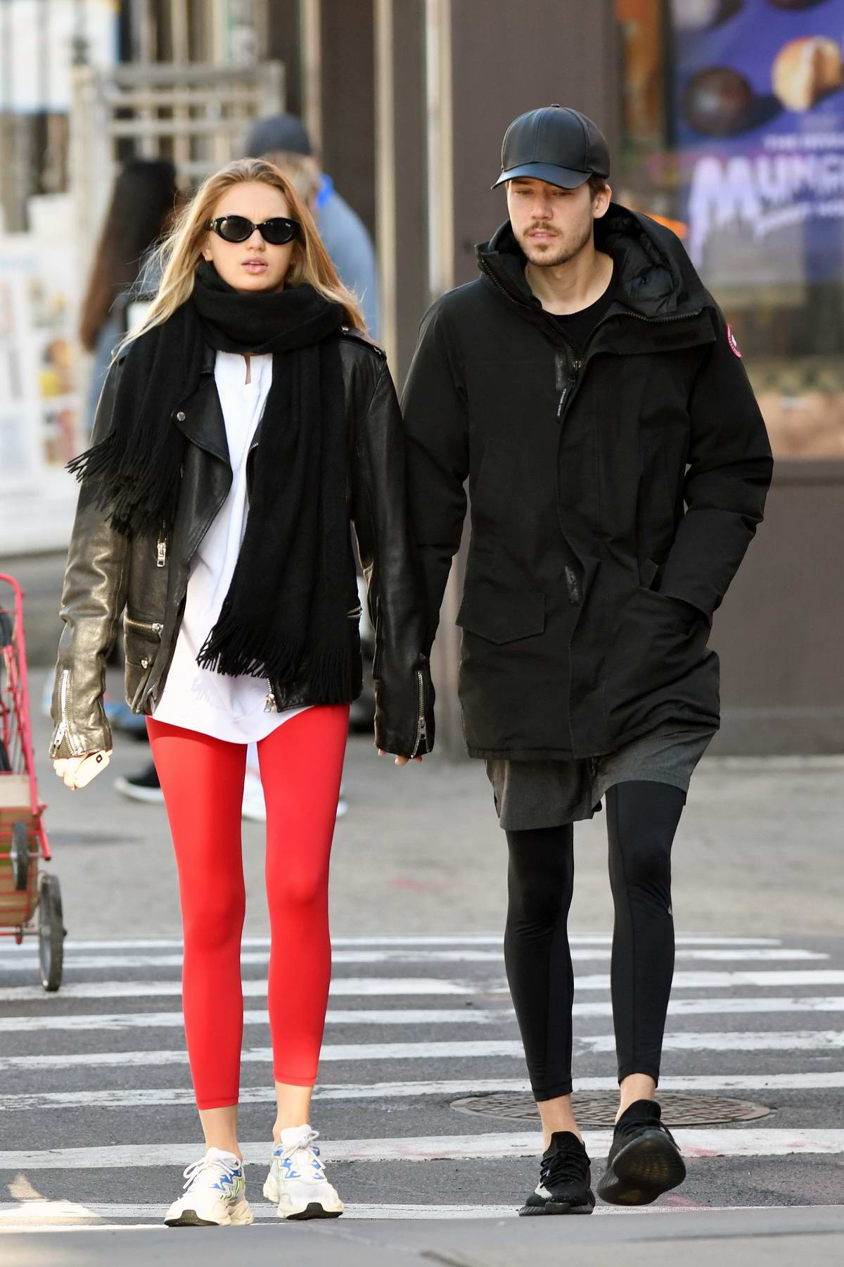 Romee Strijd looks striking in bright red leggings and black leather jacket while out for a stroll in New York City