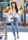 Sarah Hyland carries a bouquet of Halloween sunflowers while stepping out with her new hair style in Los Angeles