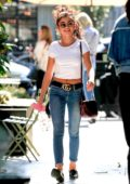 Sarah Hyland keeps a big smile on her face as she runs errands in West Hollywood, Los Angeles