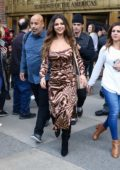 Selena Gomez dons an animal print dress as she leaves Z100 in New York City