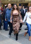 Selena Gomez dons an animal print dress as she leaves Z100 in New York City