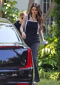 Selena Gomez looks great in black denim overalls while out in Los Angeles