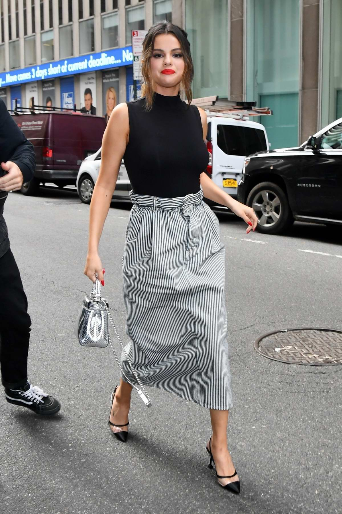 Selena Gomez looks pretty in a black top paired with striped grey skirt while visiting SiriusXM Radio in New York City