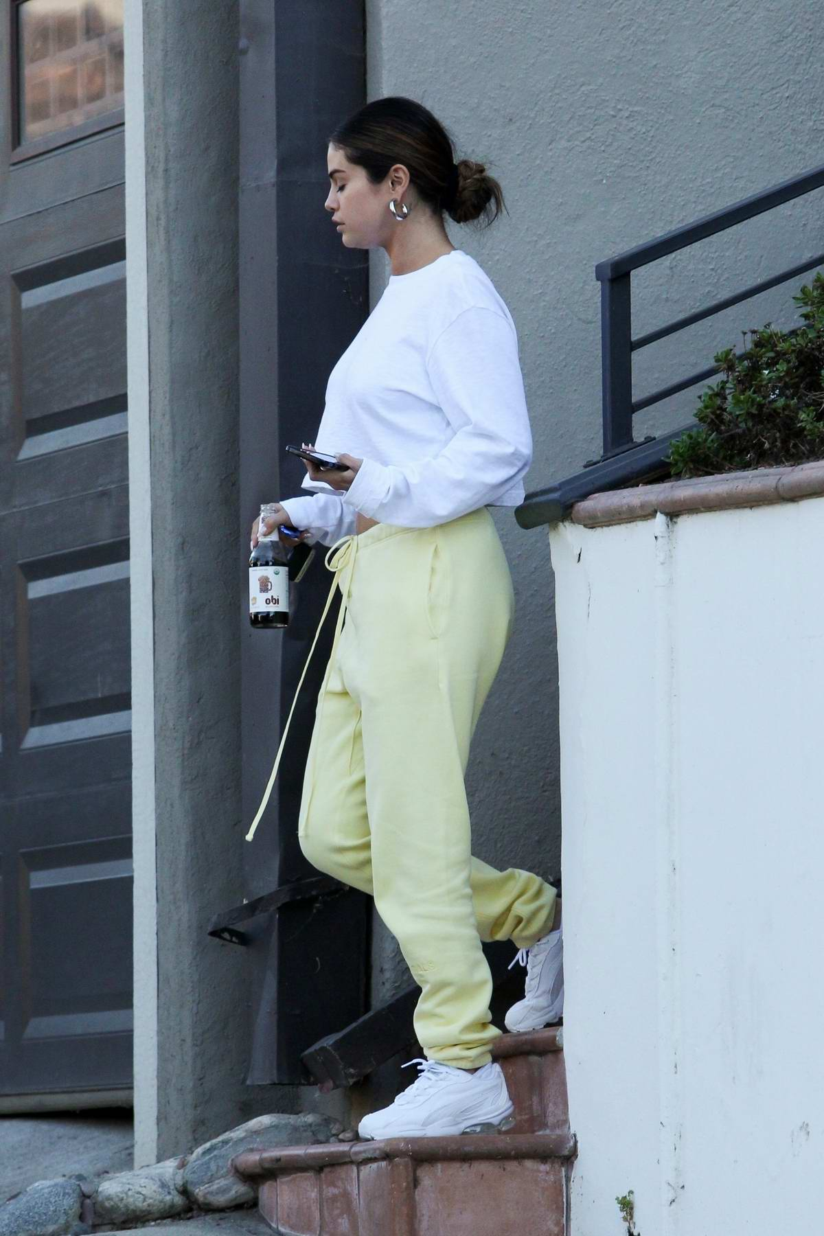 Selena Gomez sports a casual look while visiting a friend in Los Angeles