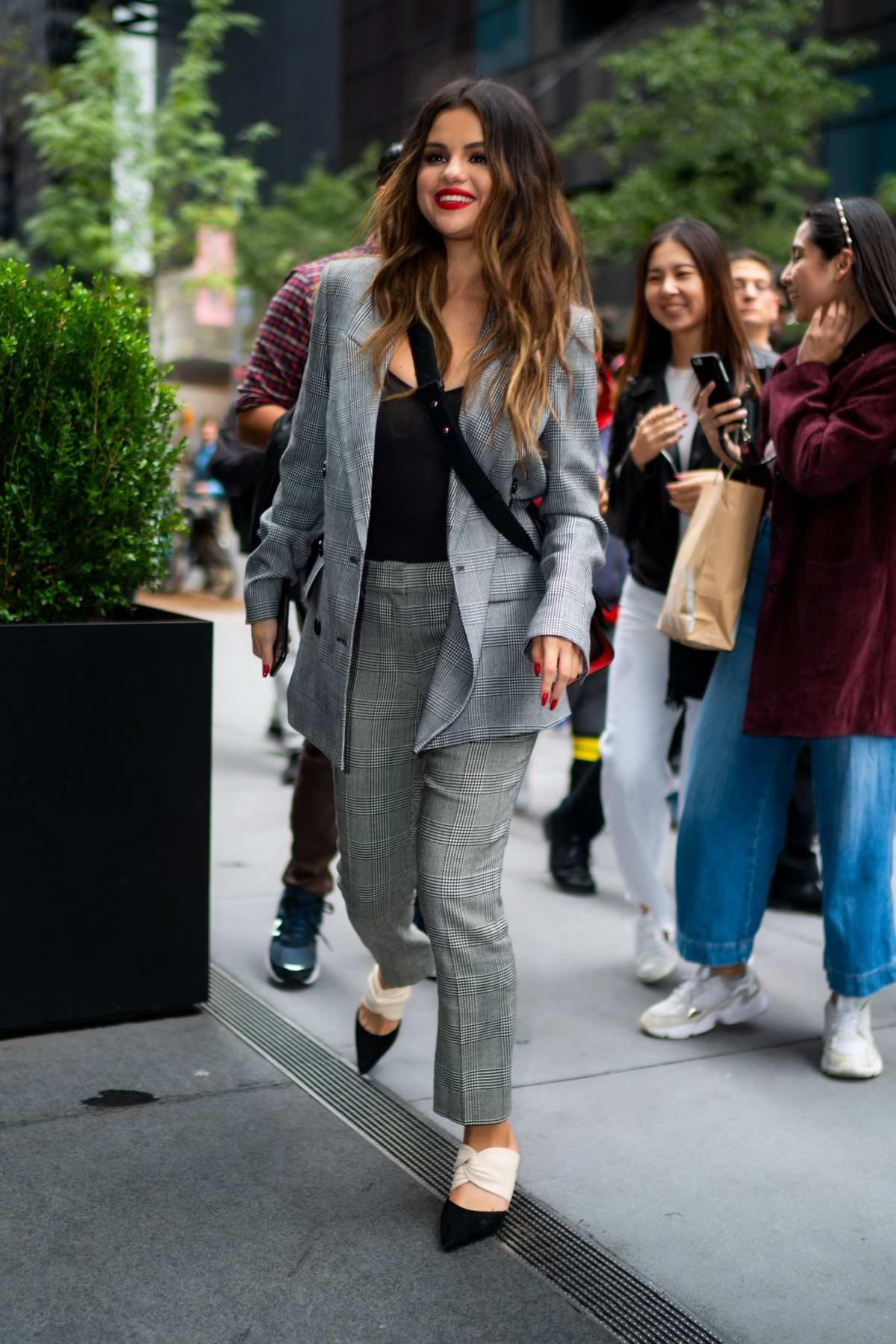 Selena Gomez takes a break while promoting her new album as she returns to her Midtown hotel in New York City