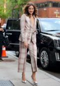 Shantel VanSanten looks chic in a plaid suit and metallic silver heels as she steps out in New York City