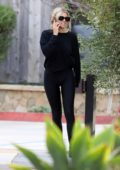 Sofia Richie sports black sweatshirt and leggings while picking up some food to go from Kristy's in Malibu, California