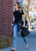 Stacy Keibler keeps it casual in a black tee and jeans while out running errands in Los Angeles