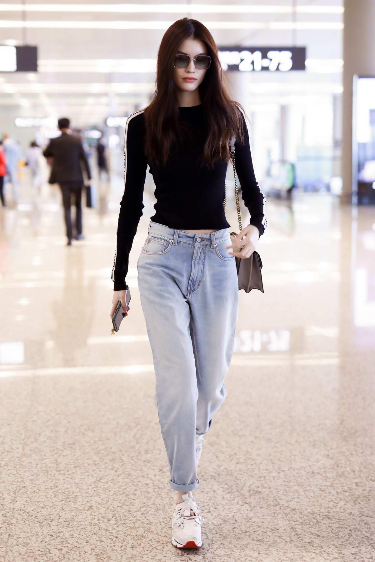 Sui He rocks a black Fiorucci top as she arrives at Shanghai Hongqiao Airport in Shanghai, China