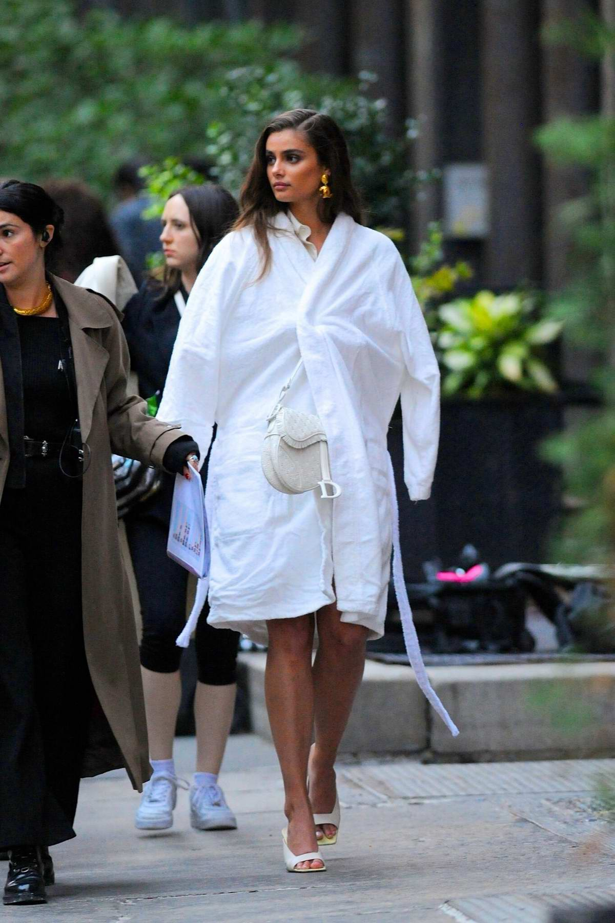 Taylor Hill stuns in all white ensemble during a photoshoot on the streets of Tribeca in New York City