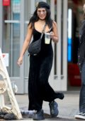 Vanessa Hudgens wears a long black velvet dress and black boots as she steps out with a friend in New York City