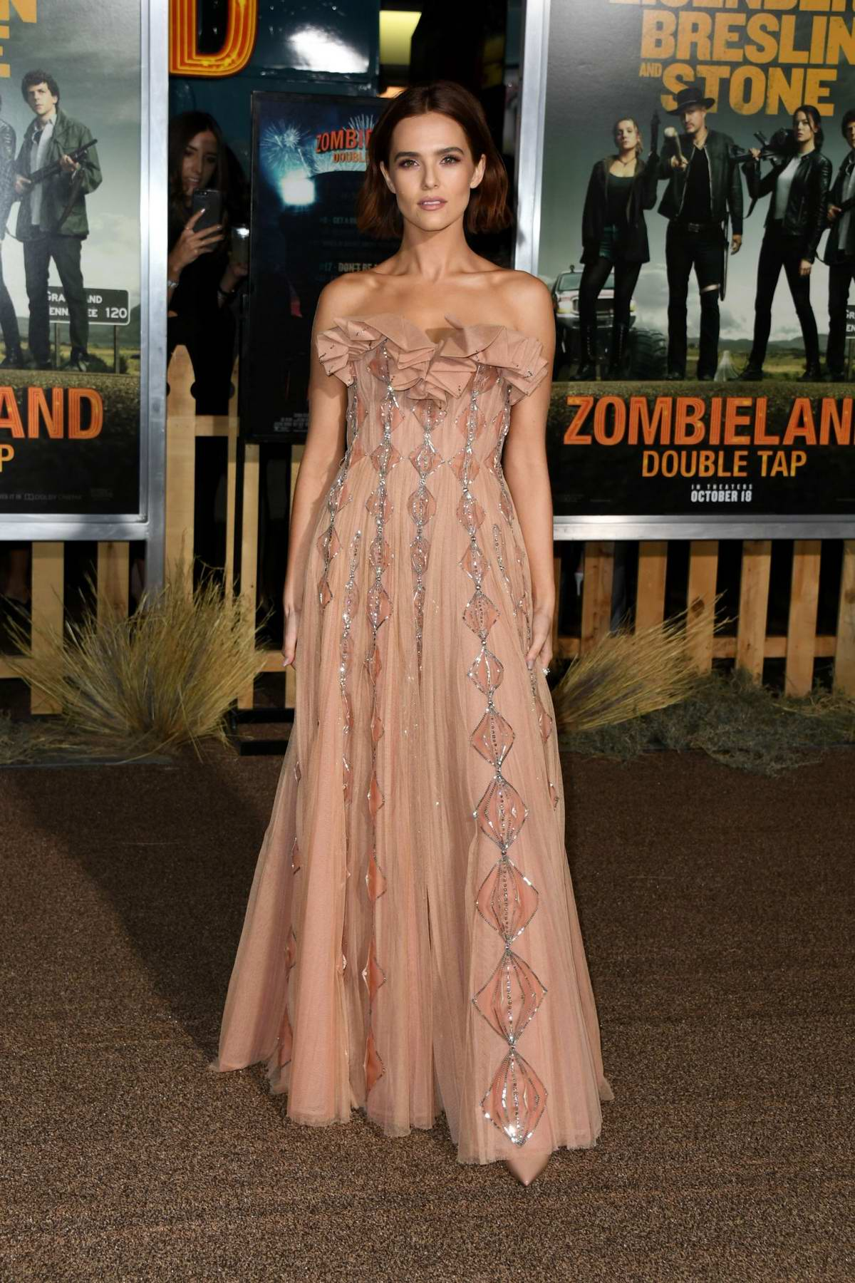 Zoey Deutch attends 'Zombieland: Double Tap' premiere at Regency Village Theater in Westwood, California