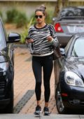 Alessandra Ambrosio looks great in an animal print top and black leggings as she heads to the gym in Los Angeles