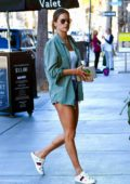 Alessandra Ambrosio shows off her supermodel legs in denim shorts as she steps out in Santa Monica, California