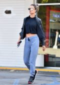 Alessandra Ambrosio shows off her toned abs in a black crop top while out for a hike a friend and her pup in Brentwood, California