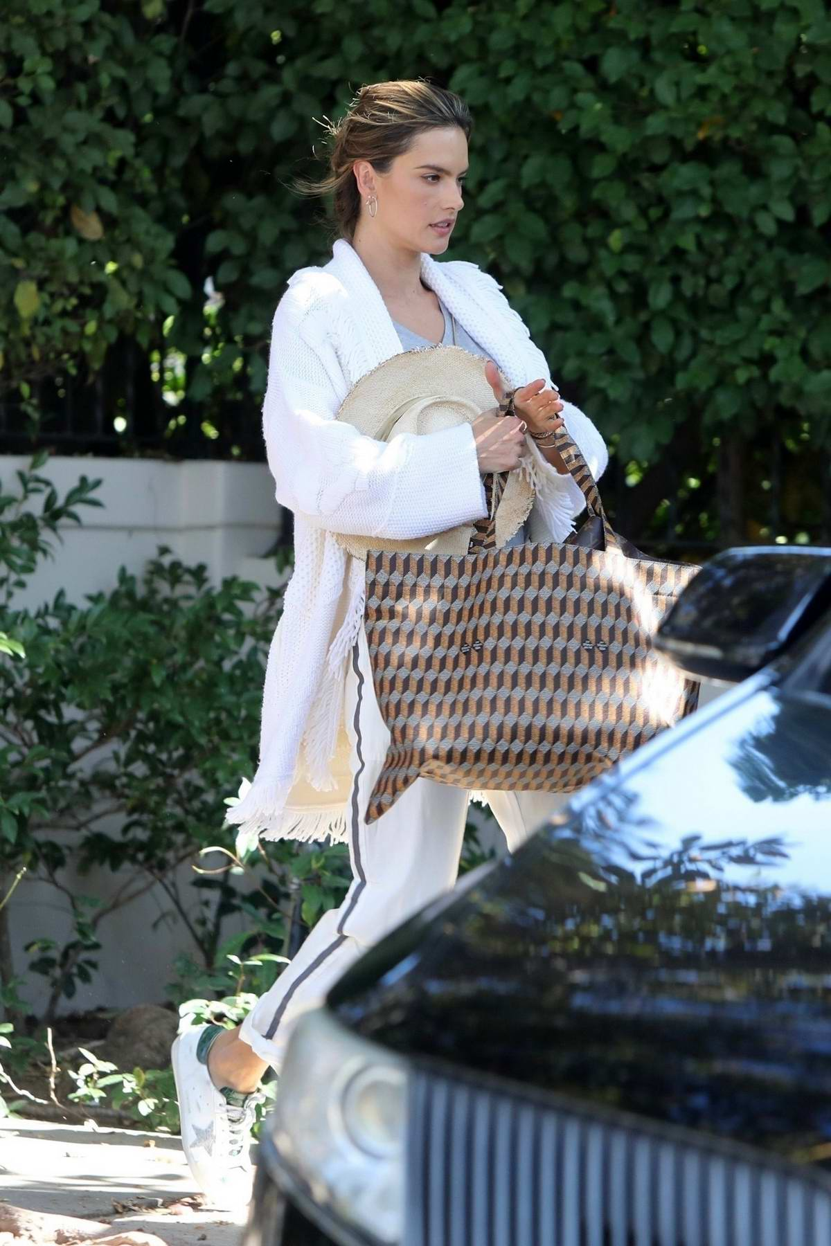 Alessandra Ambrosio sports an all-white look while heading to LAX airport, Los Angeles