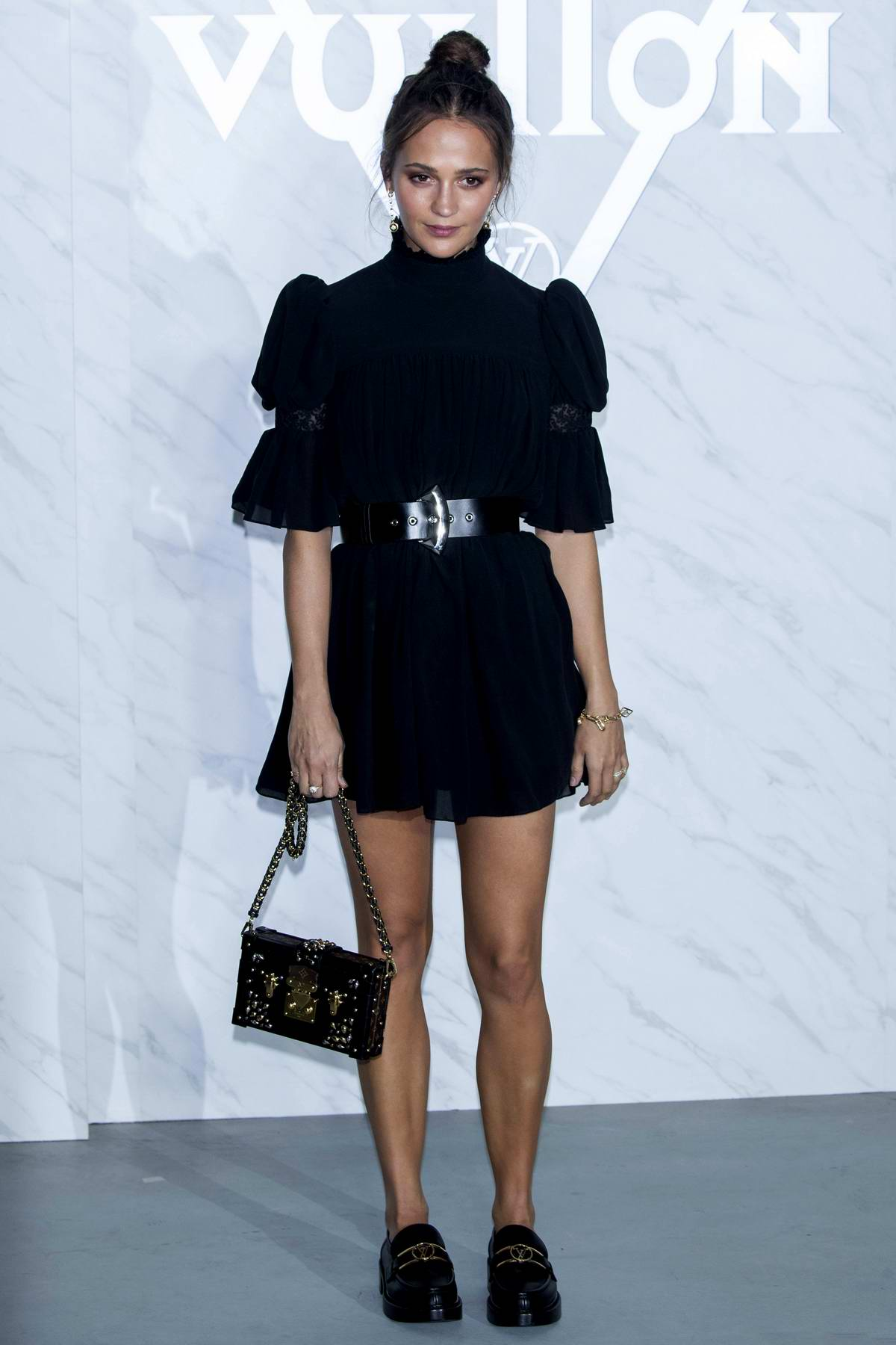 Alicia Vikander attends a photocall for the Louis Vuitton launch at Incheon International Airport in Seoul, South Korea