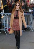 Anna Kendrick dons a tan overcoat and patterned dress while arriving at Good Morning America in New York City