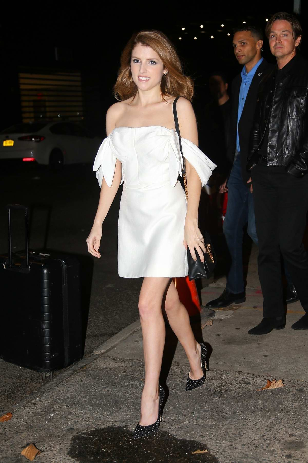 Anna Kendrick looks pretty in a white mini dress for an appearance on 'The Daily Show with Trevor Noah' in New York City