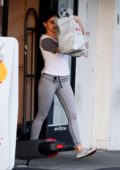 Ariel Winter covers her face with her shopping bag as she exits CVS in Los Angeles