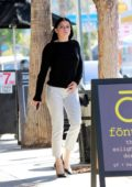 Ariel Winter looks chic in a black top and checkered white pants while heading to a business meeting in Los Angeles