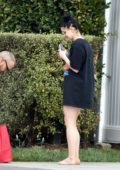 Ariel Winter spotted in a black oversized t-shirt while taking a DoorDash delivery to her front steps in Studio City, California
