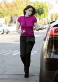 Ariel Winter wears a fuchsia top and black jeans as she steps out in Los Angeles