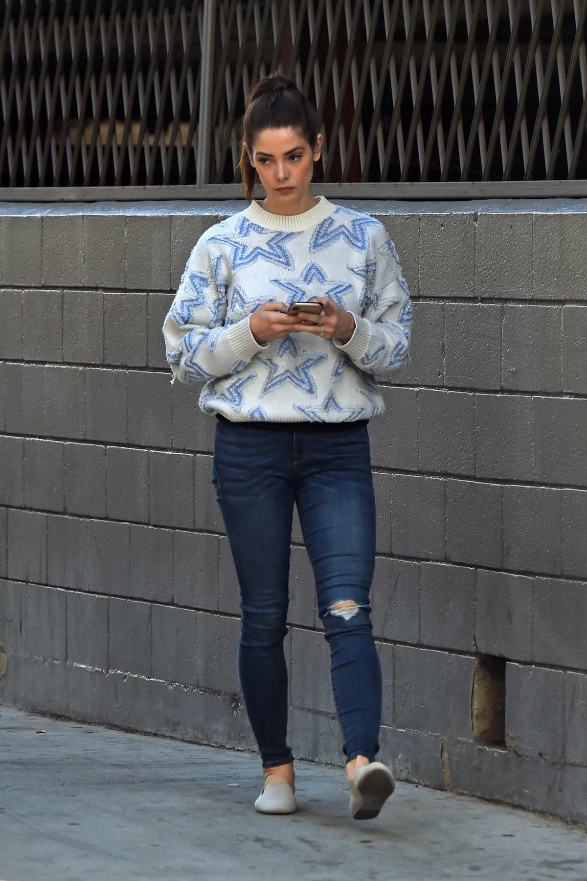 Ashley Greene seems busy on her phone while running errands in Los Angeles