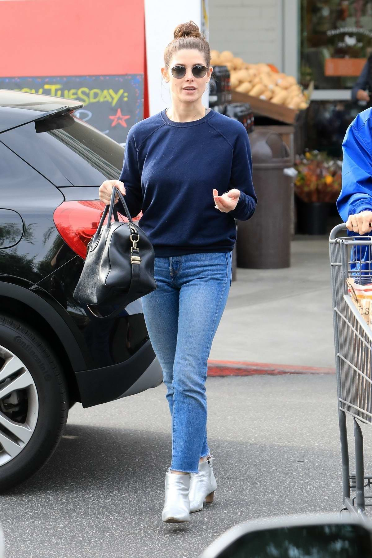 Ashley Greene wears a blue top and jeans as she goes shopping for groceries with a friend in Beverly Hills, Los Angeles