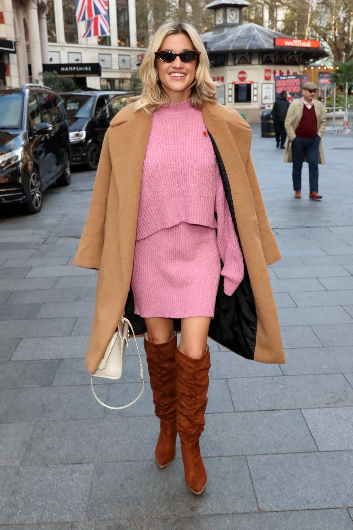 Ashley Roberts looks pretty in a pink dress and knee high suede boots exits Heart Radio in London, UK