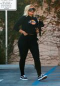 Bebe Rexha sports a cropped black hoodie and leggings as she arrives at a studio in Los Angeles