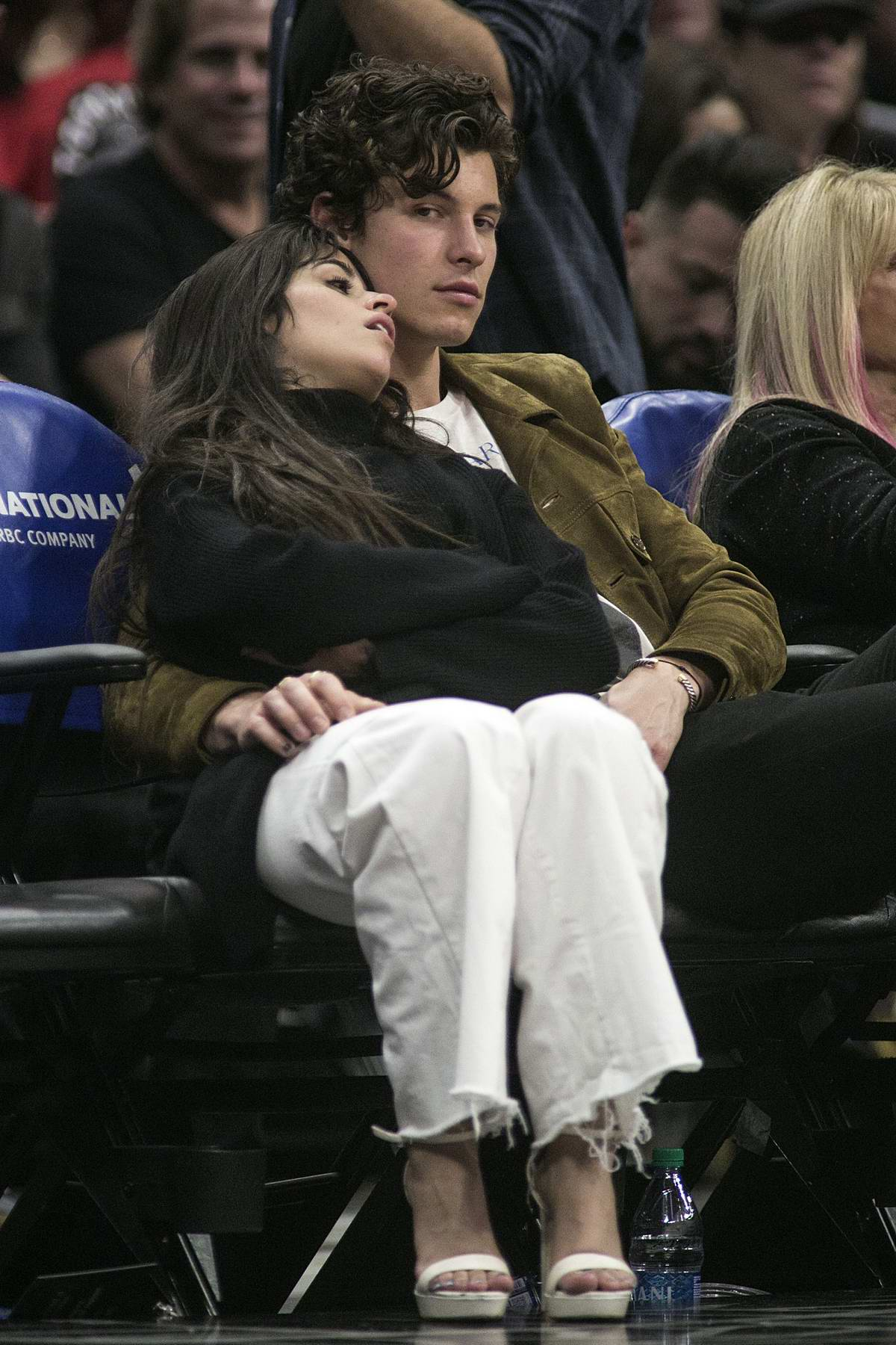 Camilla Cabello and Shawn Mendes pack on some PDA during Los Angeles Clippers vs Toronto Raptors game in Los Angeles