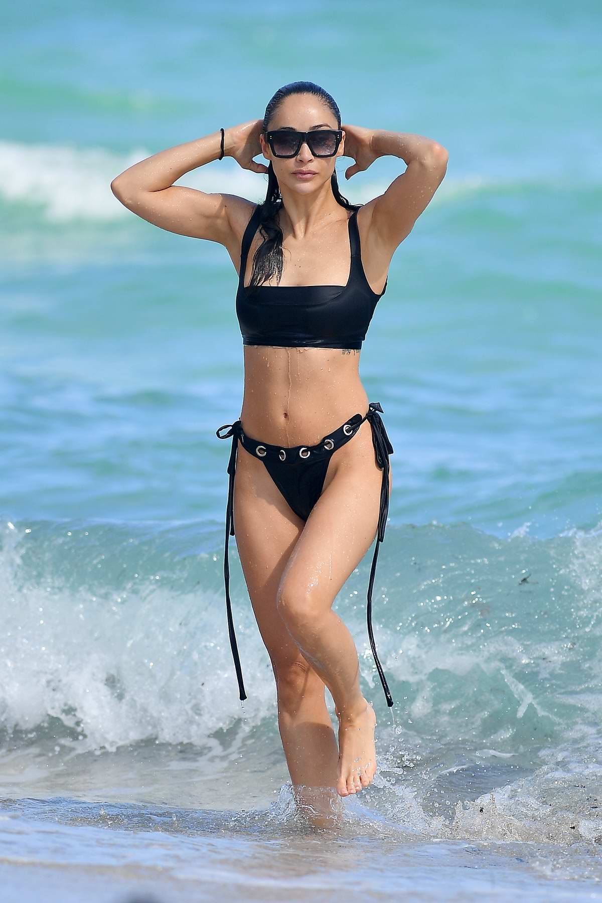 Cara Santana rocks a black bikini while enjoying a day in Miami Beach, Florida
