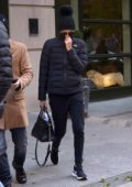 Charlize Theron bundles up in a black puffer jacket and a beanie as she leaves her hotel on a chilly day in New York City