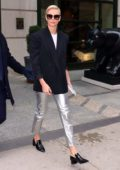 Charlize Theron looks chic in black blazer paired with silver pants as she leaves her hotel in New York City