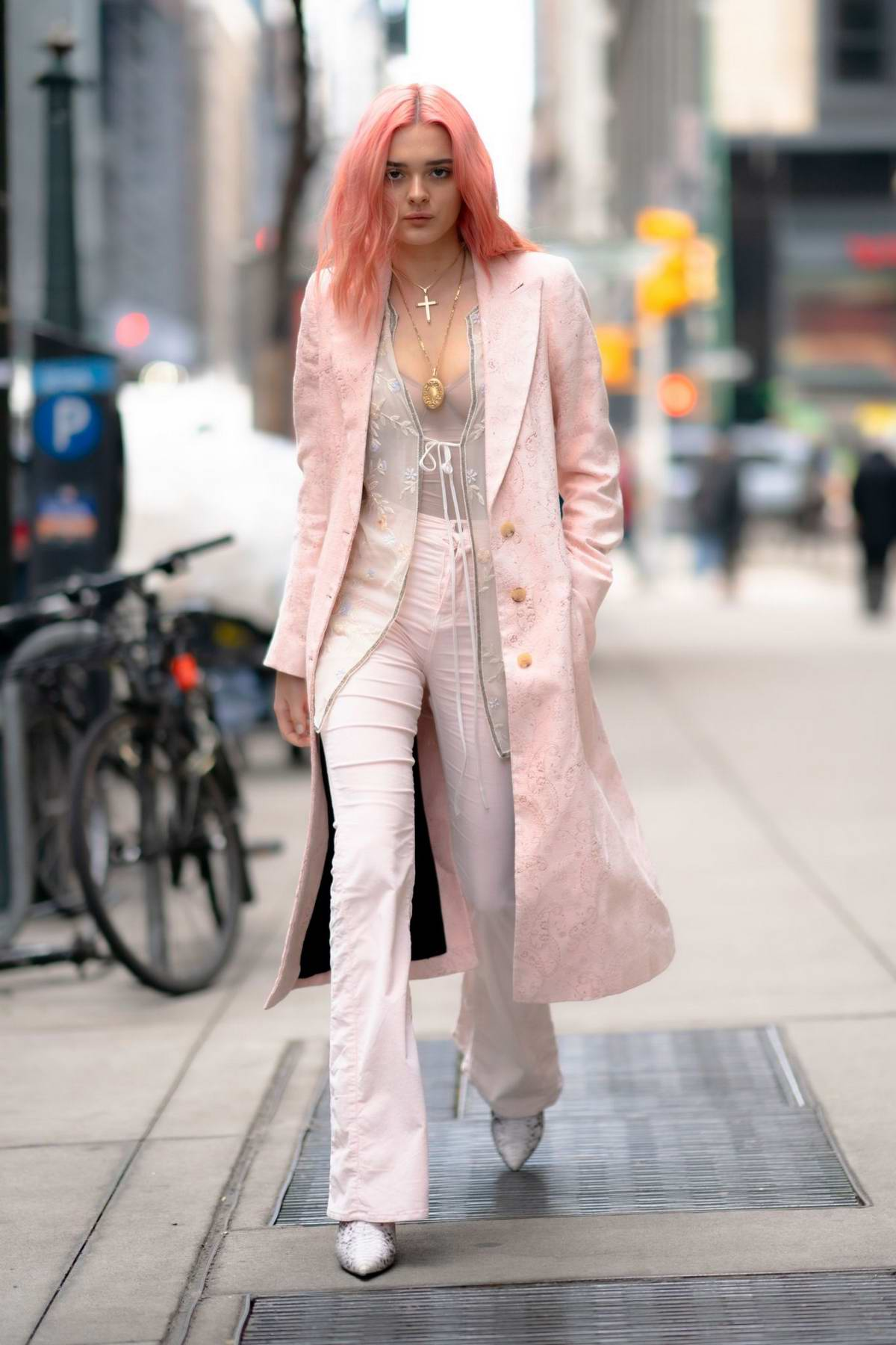Charlotte Lawrence looks stunning in a light pink ensemble as she steps out in New York City