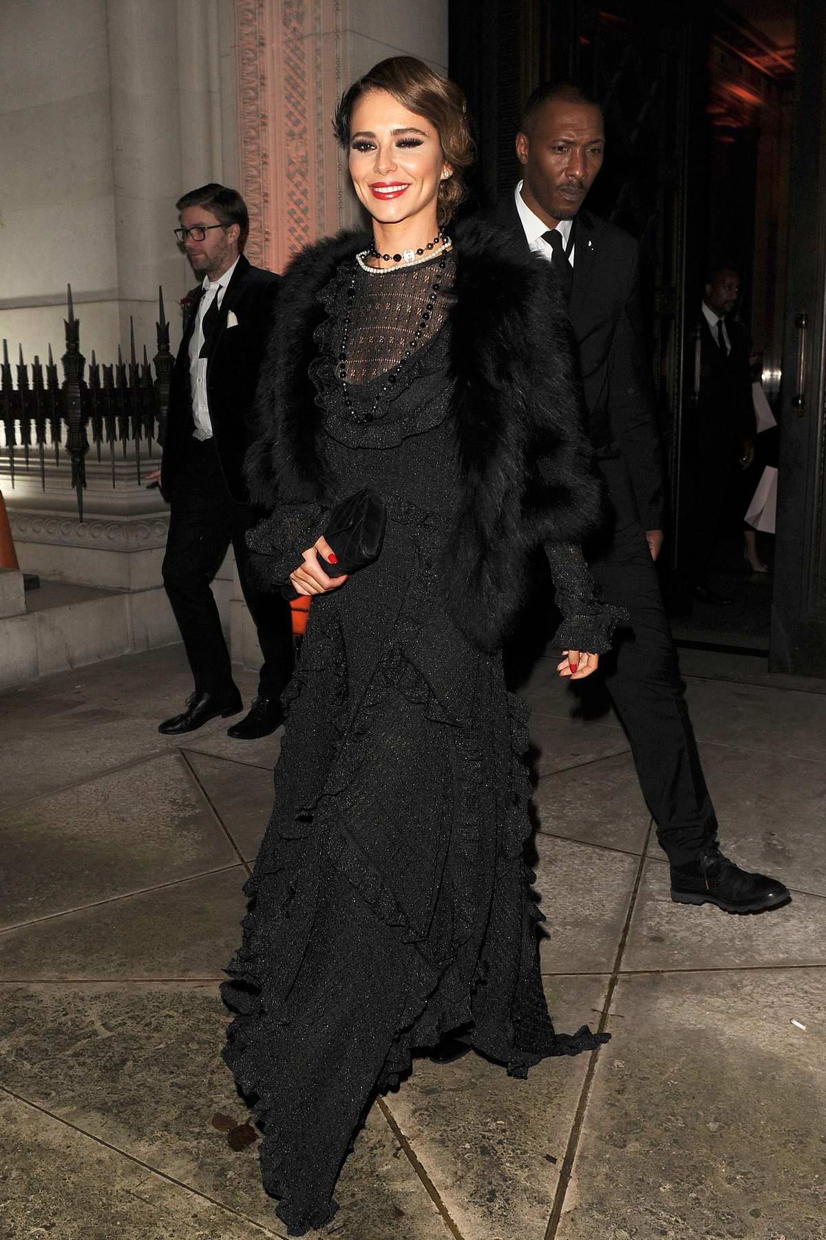 Cheryl Tweedy looks great in a vintage black lace dress while leaving the Freemasons Hall in Covent Garden, London, UK