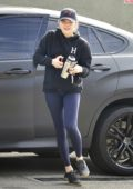 Chloe Grace Moretz sports a black hoodie and black leggings as she arrives to Rise Nation studio for a workout in Los Angeles