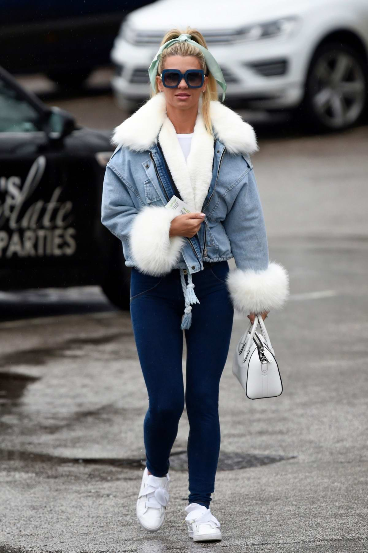 Christine McGuinness seen wearing a fur-lined denim jacket and blue denim leggings as she steps out in Chesire, UK
